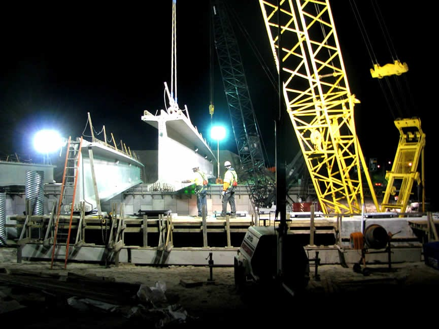 "Setting 155-ft long 85"" tall, 85-ton Precast Bulb T Beams over Great Bridge Blvd. at night with two 200-ton cranes"