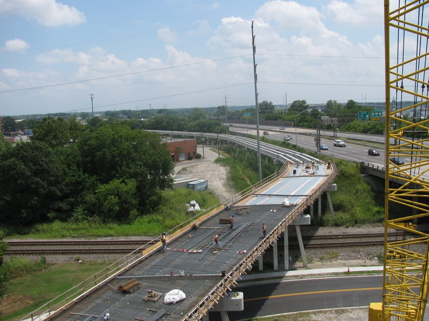 Metal decking installation, rebar installation, and bridge deck forming over Holt Street and Norfolk Southern Railroad tracks.