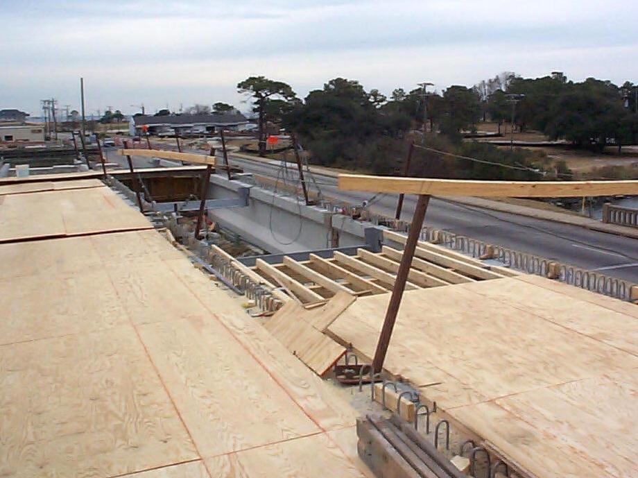 Wood flooring installation for bridge deck construction