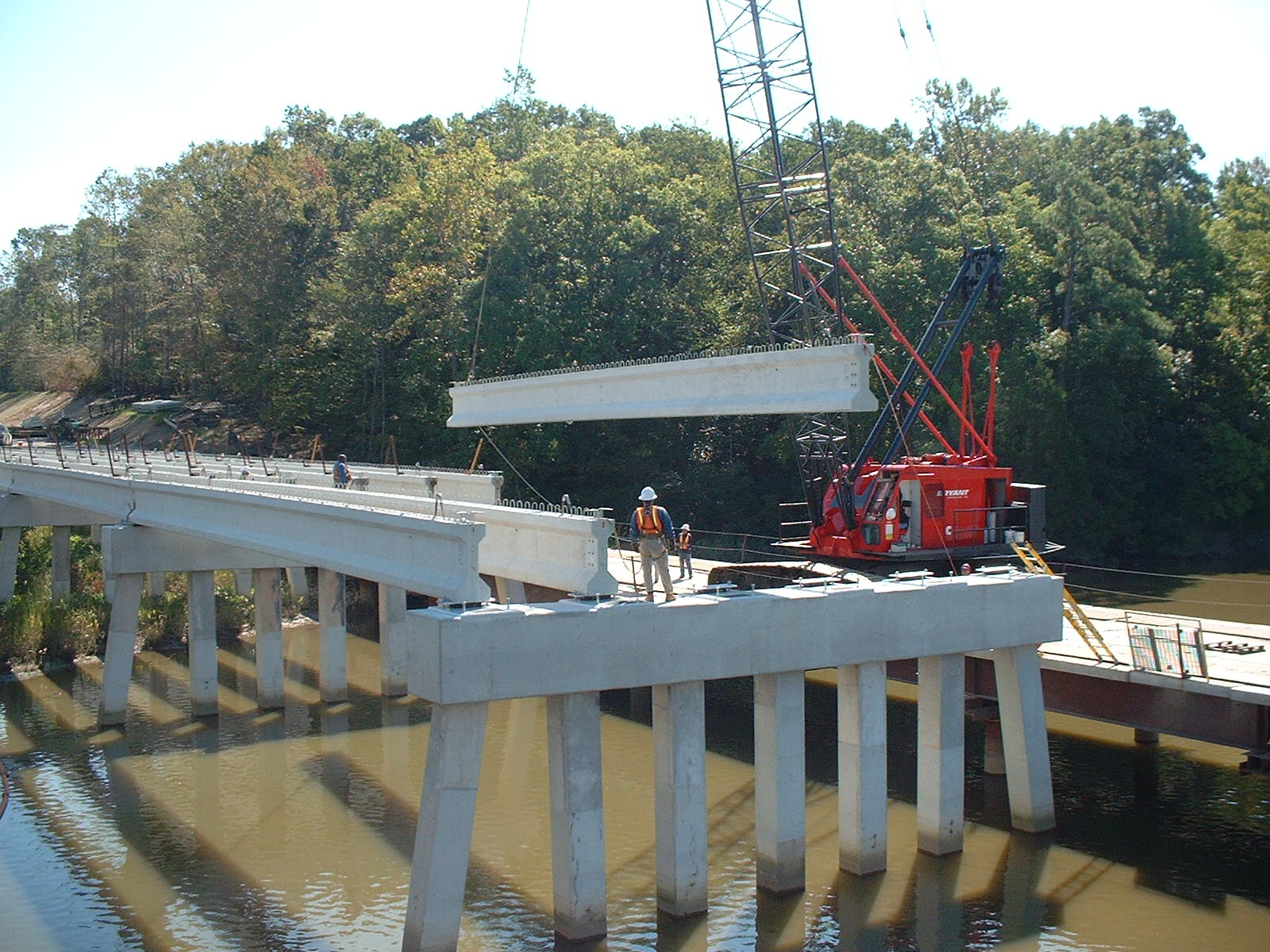 Erecting beams from temporary work trestle