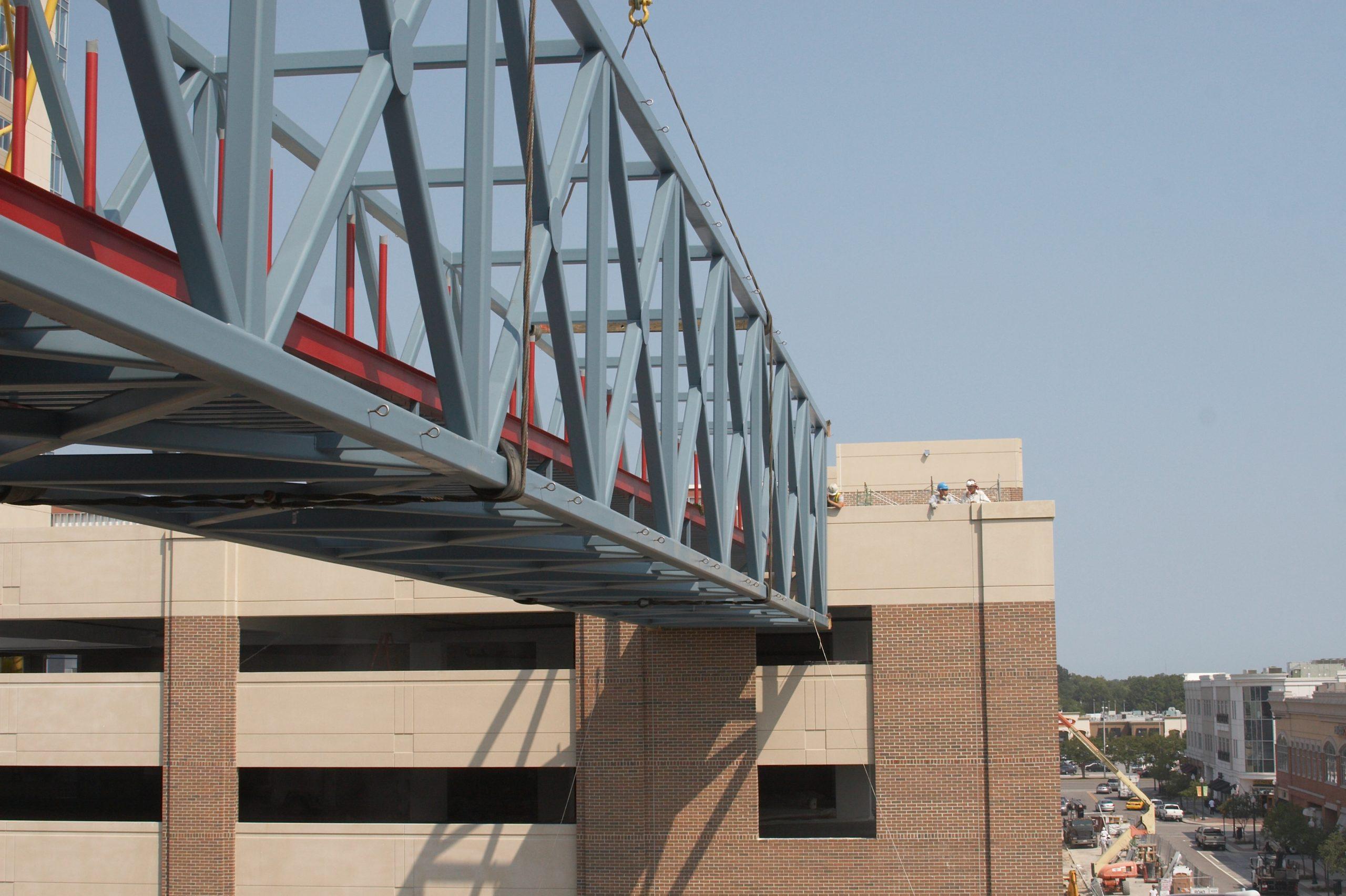 Lowering the bridge between two existing buildings