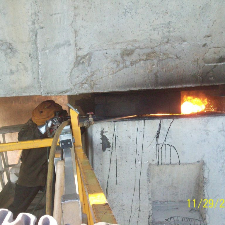 A lancing rod is used to remove an existing brige bearing.